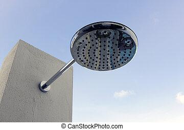 """A modern \""""rain shower\"""" shower head outdoors - A modern..."""