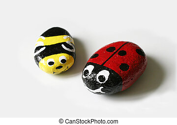 Rocks decorated as insects - isolated.