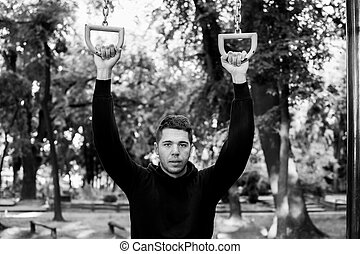 Man in street workout session - Photo was taken in early...