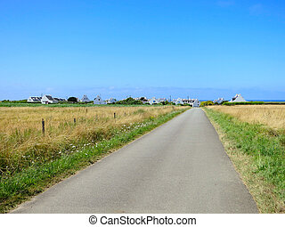 Road through the summer field Brittany, France - Road...
