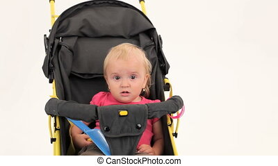 Little Girl Sitting In Pram And Smiling - Portrait of a cute...
