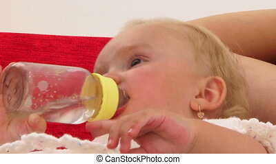 Cute Baby Drinking From Bottle - This is a portrait of a...