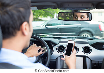 Texting and driving cause traffic accidents - Closeup...