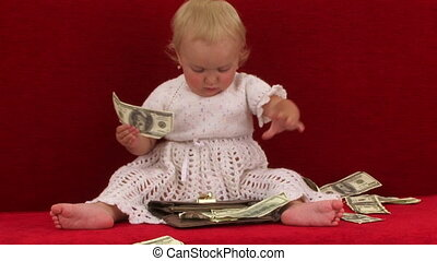 Cheerful Cute Little Girl Playing With Wallet Full Of Dollars