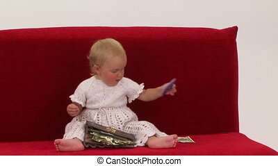 Cheerful Little Girl Playing With Wallet Full Of Dollars -...