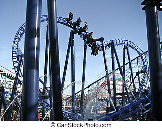 Roller coaster - people having fun on roller coaster in...