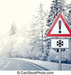 Curvy Winter Road with Warning Sign - Winter country road...