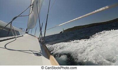 Sailing yacht race Ship yachts with white sails in the open...
