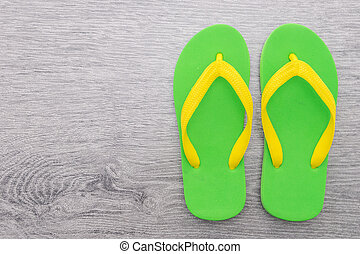 Flip flop on wooden background