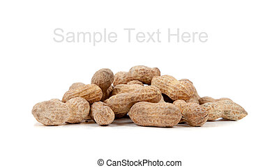 Whole peanuts on white with copy space