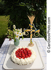 Fresh strawberry cake at a table with decorations in a...