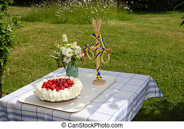Decorated summer table - Table in a garden decorated with a...