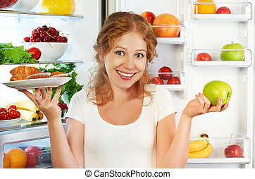 Woman on diet to choose between healthy and unhealthy food...