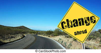 Change ahead sign  on a sky background and dessert road