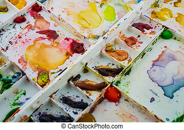 Water colors in a white palette