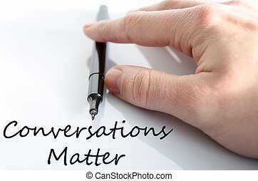 Conversation matter text concept - Pen in the hand isolated...