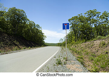 Deadlock - Road dead end sign in front of a real dead end