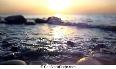 Pebble Beach and waves during amazing sunset. - Pebble Beach...