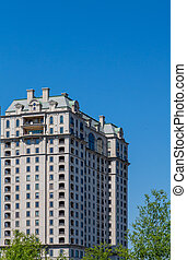 Classic Old Apartment Building Under Blue Skies