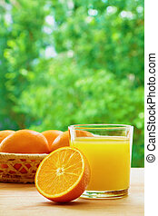 Oranges and juice - Glass of orange juice, half of orange...