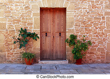 Alcudia Old Town - Wooden door of an old stone house, Spain