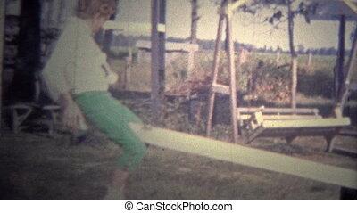 ARKANSAS, USA - 1964: Kids playing - Original vintage 8mm...
