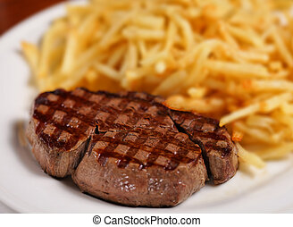 steak and french fry - grilled steak and french fry on a...