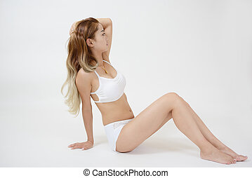 Sexy woman sitting - Attractive young woman in white...