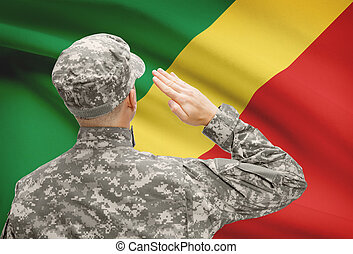 Soldier in hat facing national flag series -...