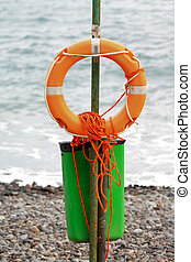 Life preserver - An orange life preserver and rope for first...