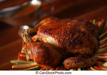 roast chicken on vegetable - roasted chicken on a plate with...