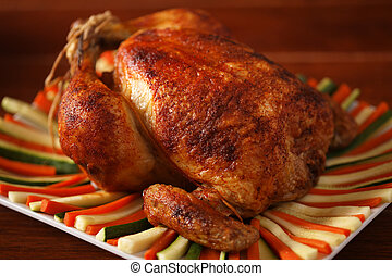 roast chicken - roasted chicken on a plate with vegetable...