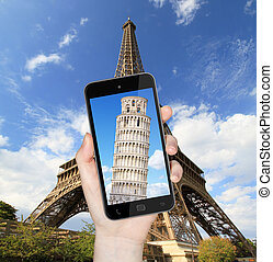 Eiffel Tower and Pise Tower - Hand taking a picture with...