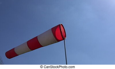 wind sock wave in wind on blue sky background. Static tripod...