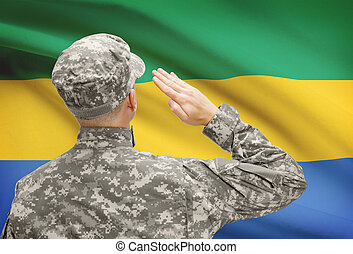 Soldier in hat facing national flag series - Gabon -...