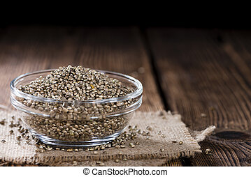 Hemp Seeds (close-up shot) on an old wooden table
