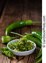 Portion of green Chilis on vintage wooden background