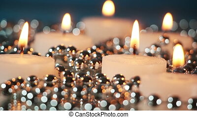 burning candles and christmas beads loopable