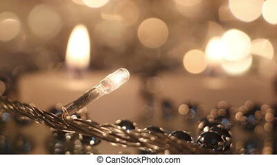 candles and christmas lights close-up rack focus