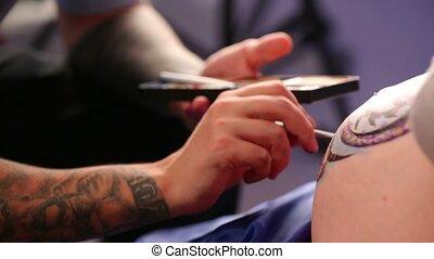Body Art Artist - Body art artist finishing his work