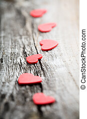 Red hearts - Little red hearts on old wooden background