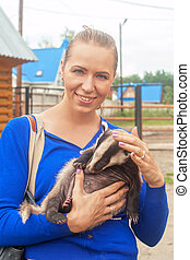 badger - Young attractive woman with badger
