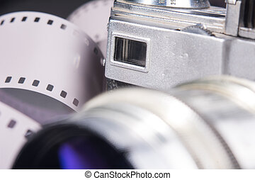 Close-up of old photo camera with a metal lens and viewfinder.