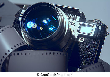 Close-up of old photo camera with metallic color