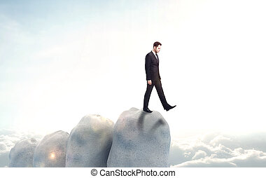 businessman falls into the abyss on sky background