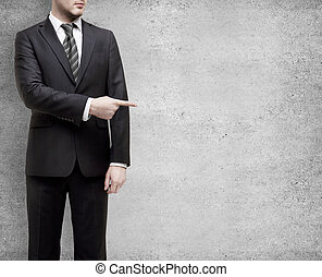 businessman shows finger - businessman standing in suit and...