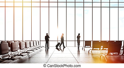 businesspeople in airport - businesspeople with luggage in...