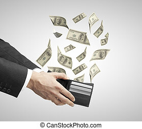 purse from which emerge dollars - businessman hand holding a...