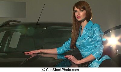 Young Pretty Model Posing Standing At Black Car - This is a...