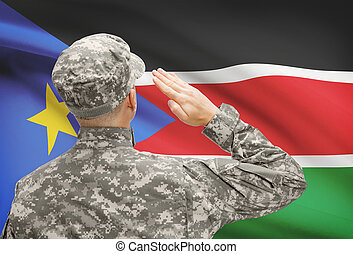 Soldier in hat facing national flag series - South Sudan -...